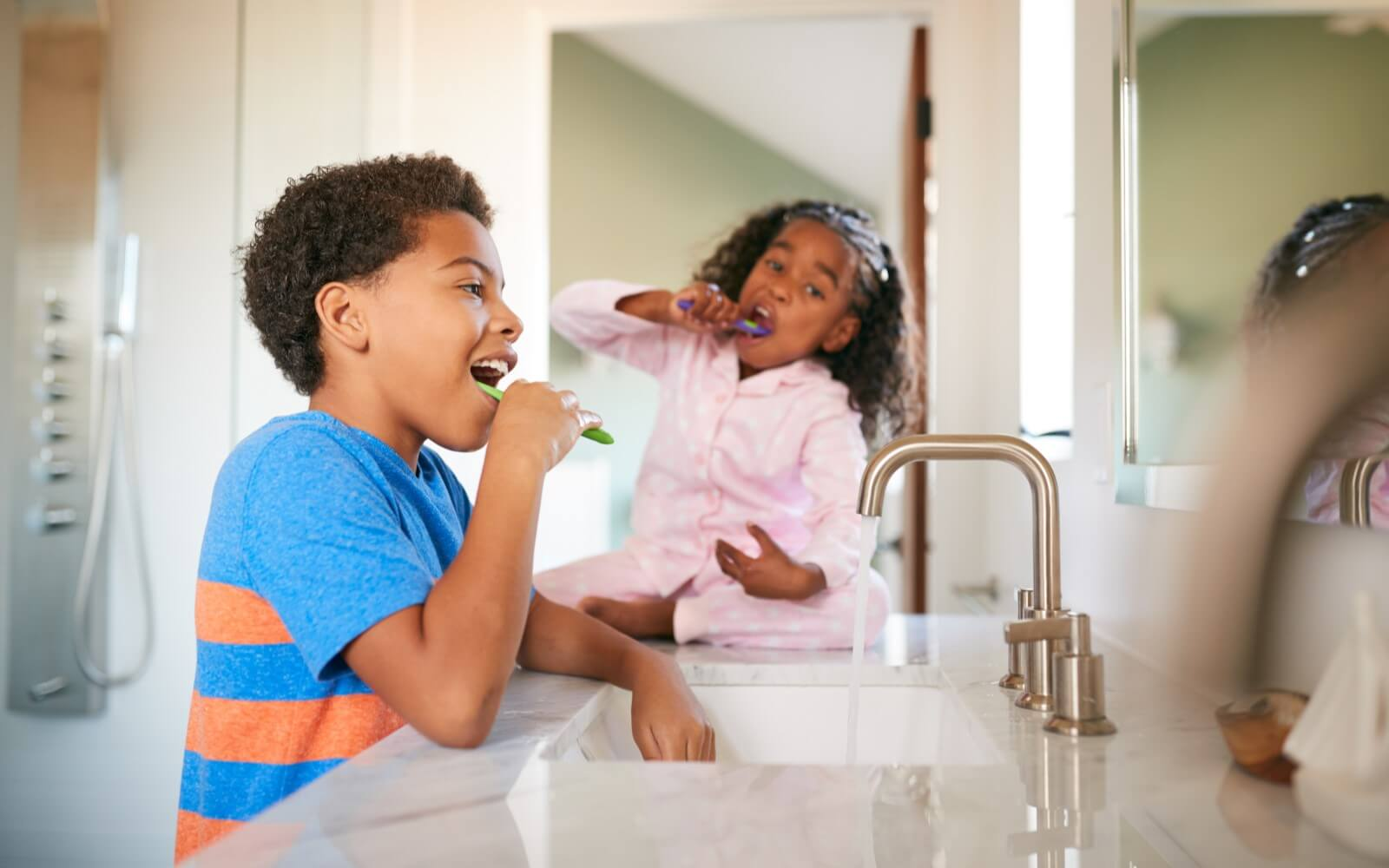 brush your teeth after every meal two kids brushing their teeth in the bathroom